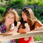 girls enjoying a 99 flake soft ice cream
