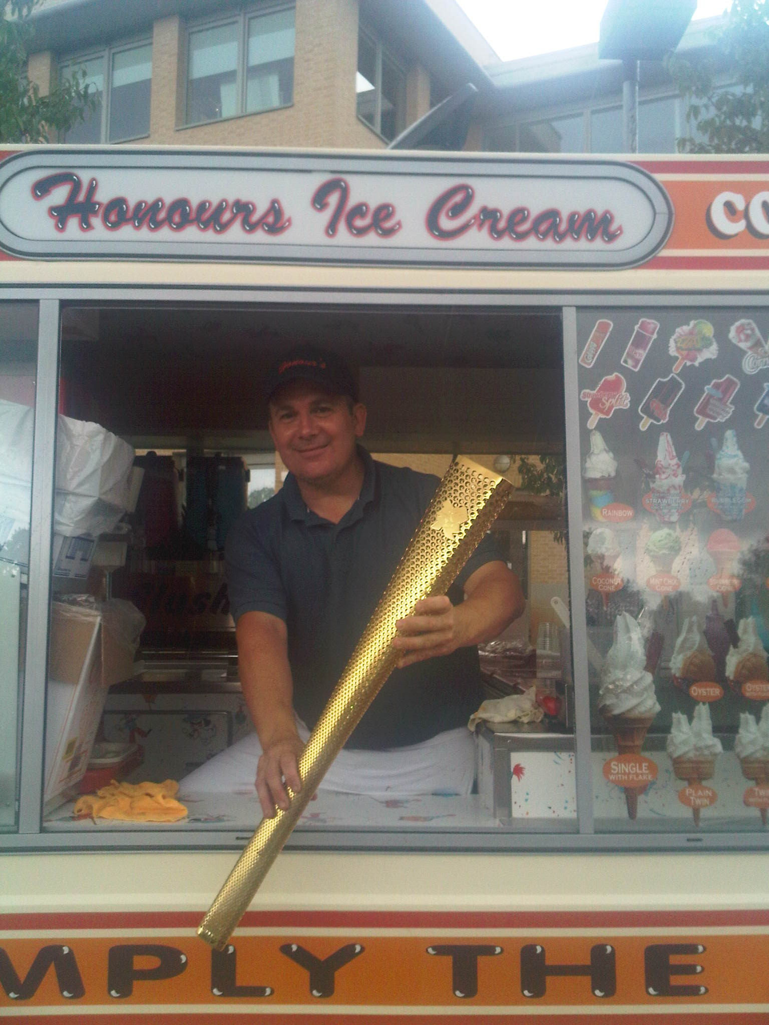 Onur with the Olympic Torch at a corporate event we were hired to cater 20th July 2012